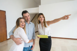 Real estate agent showing a house to a couple